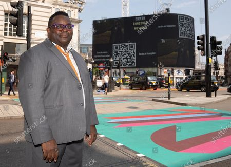 Stock Image of Isaac Julien CBE attends The Piccadilly Art Takeover.The Piccadilly Art Takeover was unveiled today in London - a large-scale public art commission of the iconic area in the capital, with artists associated with the Royal Academy of Arts designing flags, pedestrian crossings and filmed pieces for the 780 sqm Piccadilly Lights. The takeover marks the beginning of a season of free, accessible public art in the area.