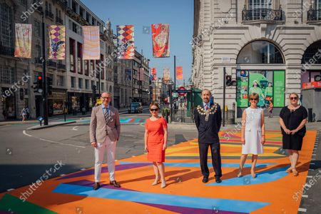 Mark Williams (Director of Destination Marketing), Ros Morgan (Chief Exec of Holba), Cllr Jonathan Glanz (The Right Honourable Lord Mayor of Westminster), Cllr Rachael Robathan (Leader of Westminster City Council) and Rebecca Lyons (Director of Collections and Learning at Royal Academy) attend The Piccadilly Art Takeover.The Piccadilly Art Takeover was unveiled today in London - a large-scale public art commission of the iconic area in the capital, with artists associated with the Royal Academy of Arts designing flags, pedestrian crossings and filmed pieces for the 780 sqm Piccadilly Lights. The takeover marks the beginning of a season of free, accessible public art in the area.