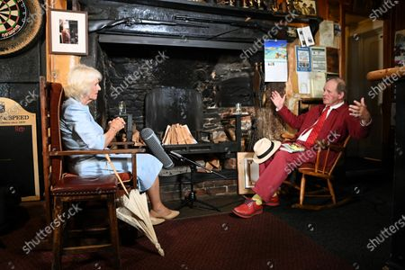 Stock Image of Camilla Duchess of Cornwall visits the Duke of York Inn in Iddesleigh to join author Sir Michael Morpurgo at a lunch club for local residents, the first since the pandemic began. During the visit, Her Royal Highness will hear how Sir Michael met the man who inspired his novel â€War Horse†at the pub and discuss why she chose the book for Season 3 of The Duchess of Cornwallâ€s Reading Room.