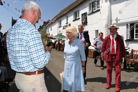 Stock Photo of Camilla Duchess of Cornwall visits the Duke of York Inn in Iddesleigh to join author Sir Michael Morpurgo at a lunch club for local residents, the first since the pandemic began. During the visit, Her Royal Highness will hear how Sir Michael met the man who inspired his novel â€War Horse†at the pub and discuss why she chose the book for Season 3 of The Duchess of Cornwallâ€s Reading Room.
