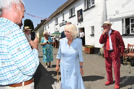 Stock Picture of Camilla Duchess of Cornwall visits the Duke of York Inn in Iddesleigh to join author Sir Michael Morpurgo at a lunch club for local residents, the first since the pandemic began. During the visit, Her Royal Highness will hear how Sir Michael met the man who inspired his novel â€War Horse†at the pub and discuss why she chose the book for Season 3 of The Duchess of Cornwallâ€s Reading Room.