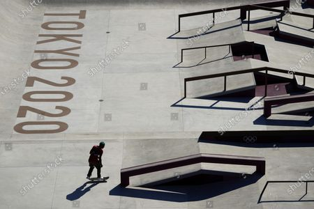 Manny Santiago, of Puerto Rico, trains during a street skateboarding practice session at the 2020 Summer Olympics, in Tokyo, Japan