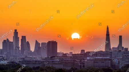 There was a spectacular Freedom Day sunrise over Battersea in London this morning (Mon,July 19)) as most restrictions were finally removed in England.James Burns took pictures of the golden sunrise over buildings and office blocks in the city.The dawn of a new era comes as restrictions on social distancing and face masks are officially removed.