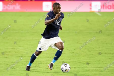 Joel Campbell (12 Costa Rica) fastly dribbles at the Jamaica defense during the CONCACAF Gold Cup game between Costa Rica and Jamaica at Exploria Stadium in Orlando, Florida.