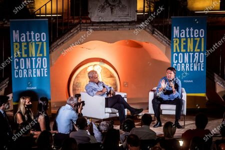 """Italian senator and leader of Italia Viva party Matteo Renzi interviewed by the journalist Enrico Mentana (L) during the presentation of his book """"Contro Corrente"""""""
