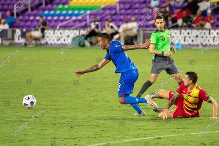 Gabriel Torres (9 Panama) gets past Oliver Norburn (6 Grenada) during the CONCACAF Gold Cup game between Panama and Grenada at Exploria Stadium in Orlando, Florida.