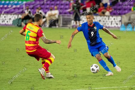 Gabriel Torres (9 Panama) maintains the ball in possession at the top of the box during the CONCACAF Gold Cup game between Panama and Grenada at Exploria Stadium in Orlando, Florida.
