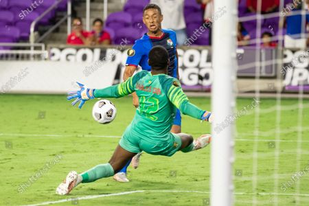 Reice Charles Cook (12 Grenada) blocks a shot from Gabriel Torres (9 Panama) during the CONCACAF Gold Cup game between Panama and Grenada at Exploria Stadium in Orlando, Florida.