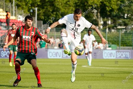 Mauro Icardi of PSG shields the ball from Tobias Strobl of FC Augsburg