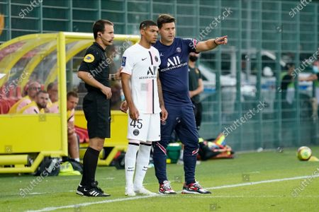 Stock Picture of PSG coach Mauricio Pochettino gives advice to substitute Alexandre Fressange of PSG