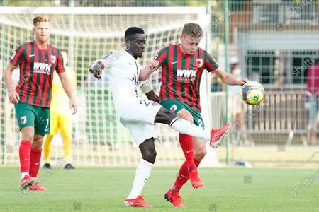 Idrissa Gana Gueye of PSG competes with Alfred Finnbogason of FC Augsburg