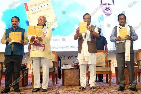 Stock Photo of RSS Chief Mohan Bhagwat along with Assam CM Himanta Biswa Sarma and author Nani Gopal Mahanta during the launching ceremony of Nani Gopal Mahanta's book on NRC & CAA debate, in Guwahati, India on July 21, 2021.