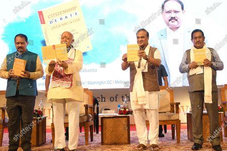 RSS Chief Mohan Bhagwat along with Assam CM Himanta Biswa Sarma and author Nani Gopal Mahanta during the launching ceremony of Nani Gopal Mahanta's book on NRC & CAA debate, in Guwahati, India on July 21, 2021.