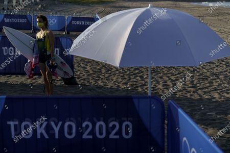 Surfer Sally Fitzgibbons, of Australia, comes out of the water after a practice session at Tsurigasaki beach at the Tokyo 2020 Olympics in Ichinomiya, Japan