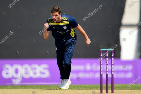Stock Picture of John Turner of Hampshire celebrates the wicket of Alastair Cook during the Royal London One Day Cup match between Hampshire and Essex Eagles at The Ageas Bowl, Southampton