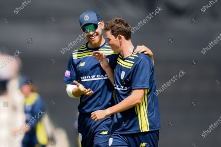 Joe Weatherley congratulates John Turner of Hampshire on his dismissal of Alastair Cook during the Royal London One Day Cup match between Hampshire and Essex Eagles at The Ageas Bowl, Southampton