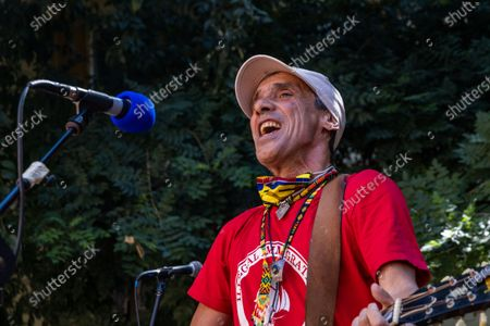 The musician Manu Chao takes part in the demonstration in Piazza Alimonda. Twenty years after the G8 and the brutal repression of the anti-globalization movement, People gathered in Piazza Alimonda, in Turin, Italy, on July 20, 2021, where Carlo Giuliani was killed, in a pacific demonstration. That is a part of initiatives and events for the twentieth anniversary of the Genoa G8 held in July 2001, when the anti-globalization movement was violently repressed by the police and the young activist, Carlo Giuliani was killed.