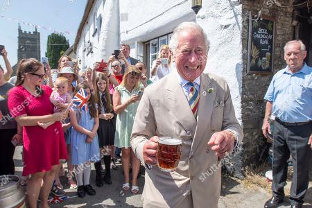 Prince Charles and Camilla Duchess of Cornwall visit to Prince Andrew Public House in deepest Devon in the village of Iddesleigh. They had lunch with the local reading Group and local writer Sir Michael Morpurgo.