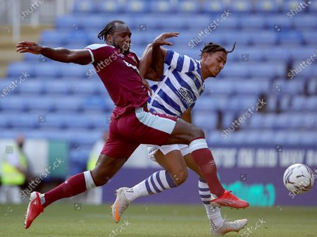 Michail Antonio of West Ham United competes for the ball