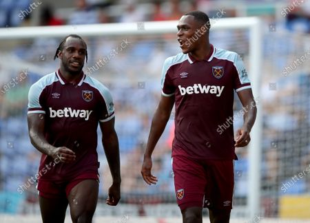 Issa Diop of West Ham United (right) with teammate Michail Antonio