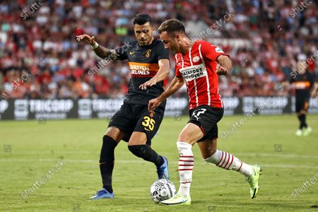 Stock Image of Aytac Kara (L) of Galatasaray in action against Mario Goetze (R) of Eindhoven during the UEFA Champions League second qualifying round, first leg soccer match between PSV Eindhoven and Galatasaray Istanbul in Eindhoven, Netherlands, 21 July 2021.