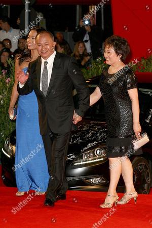 Angeles Woo, John Woo and wife Annie Woo