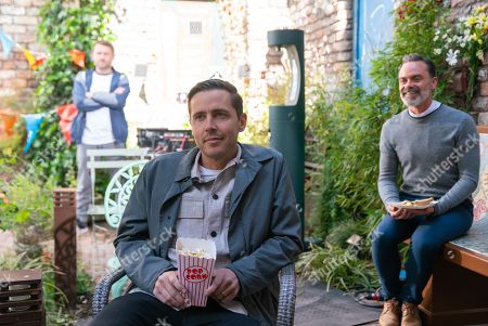 Stock Image of Coronation Street - Ep 10388 Wednesday 28th July 2021 - 1st Ep As the locals gather in Victoria Garden for the calendar launch party, Paul Foreman, as played by Peter Ash, swaps the laptop for his own. Having introduced the film, Emma presses play on the laptop To Todd Grimshaw's, as played by Gareth Pierce, horror, the film turns out to be an incriminating video of him telling Will how he successfully split up Billy Mayhew, as played by Daniel Brocklebank, and Paul.