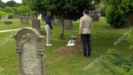 Emmerdale - Ep 9118 Thursday 5th August 2021 - 1st Ep Sarah Sugden, as played by Katie Hill, gets panicky when she bumps into Liam Cavanagh, as played by Jonny McPherson, at the graveyard and he reflects on Leanna's death and how fate just decides when it's your turn to go. Anxious Sarah rushes home where she slumps on the floor.