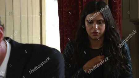 Emmerdale - Ep 9112 Thursday 29th July 2021 - 1st Ep At Leanna's funeral, Meena, as played by Paige Sandhu, covertly fiddles with Leanna's ring on her necklace. She panics when the ring falls from the necklace, watching in horror as it rolls and stops near Liam Cavanagh's, as played by Jonny McPherson, shoe.