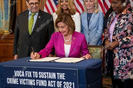 Editorial image of Bill enrollment photo op for H.R. 1652 - VOCA Fix to Sustain the Crime Victims Fund Act of 2021., Washington, District of Columbia, USA - 21 Jul 2021