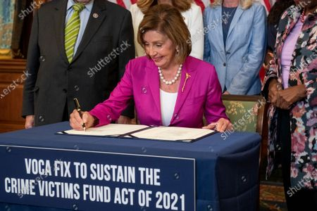 Editorial photo of Bill enrollment photo op for H.R. 1652 - VOCA Fix to Sustain the Crime Victims Fund Act of 2021., Washington, District of Columbia, USA - 21 Jul 2021