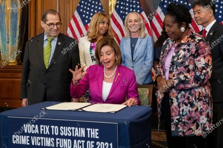 Editorial picture of Bill enrollment photo op for H.R. 1652 - VOCA Fix to Sustain the Crime Victims Fund Act of 2021., Washington, District of Columbia, USA - 21 Jul 2021