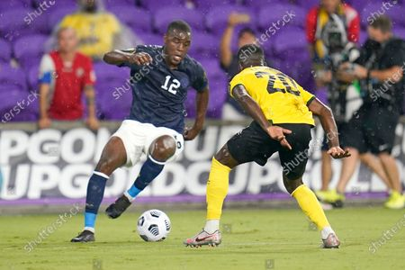 Costa Rica forward Joel Campbell (12) tries to moves the ball past Jamaica defender Kemar Lawrence (20) during the first half of a CONCACAF Gold Cup Group C soccer match, in Orlando, Fla