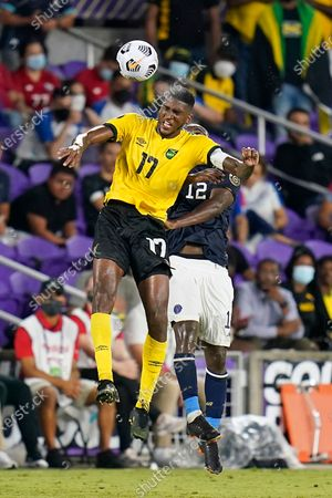 Jamaica defender Damion Lowe (17) gets position on Costa Rica forward Joel Campbell (12) in order to control a head ball during the second half of a CONCACAF Gold Cup Group C soccer match, in Orlando, Fla