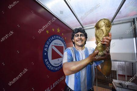 Statue of late soccer legend Diego Maradona stands at the stadium of Argentina's Argentinos Juniorsprior to a Copa Libertadores round of 16 second leg soccer match against Argentina's River Plate in Buenos Aires, Argentina