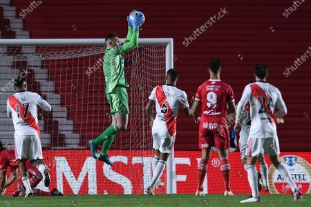 Stock Photo of Goalkeeper Franco Armani of Argentina's River Plate catches the ball during a Copa Libertadores round of 16 second leg soccer match against Argentinos Juniors in Buenos Aires, Argentina