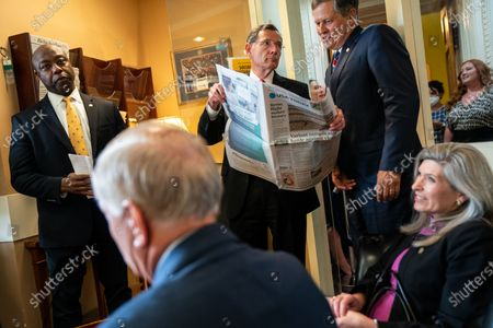 (L to R) Sen. Tim Scott (R-SC), Sen. Lindsey Graham (R-SC), Sen. John Barrasso (R-WY), Sen. Steve Daines and Sen. Joni Ernst (R-IA) talk with each other before a news conference on Capitol Hill on Wednesday, July 21, 2021. (Kent Nishimura / Los Angeles Times)
