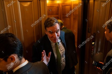 Sen. Mark Warner (D-VA) speaks with reporters outside the Senate Chamber on Capitol Hill on Wednesday, July 21, 2021. (Kent Nishimura / Los Angeles Times)