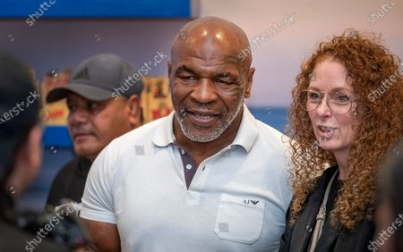 Former heavyweight champion and cannabis entrepreneur Mike Tyson signs autographs and takes photos with fans and workers while promoting his Tyson Ranch brand at Planet 13 dispensary in Santa Ana on Wednesday, July 21, 2021. (Allen J. Schaben / Los Angeles Times)