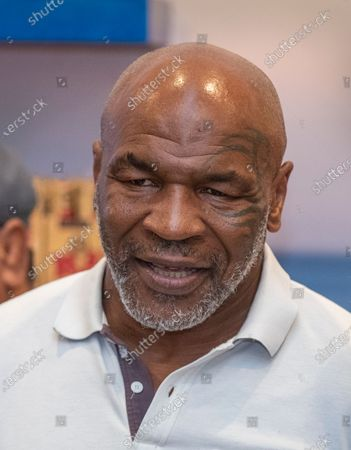 Stock Photo of Former heavyweight champion and cannabis entrepreneur Mike Tyson signs autographs and takes photos with fans while promoting his Tyson Ranch brand at Planet 13 dispensary in Santa Ana on Wednesday, July 21, 2021. (Allen J. Schaben / Los Angeles Times)