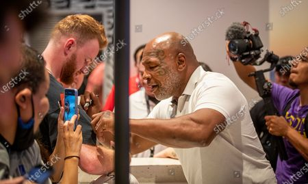 Stock Picture of Former heavyweight champion and cannabis entrepreneur Mike Tyson signs autographs and takes photos with fans while promoting his Tyson Ranch brand at Planet 13 dispensary in Santa Ana on Wednesday, July 21, 2021. (Allen J. Schaben / Los Angeles Times)