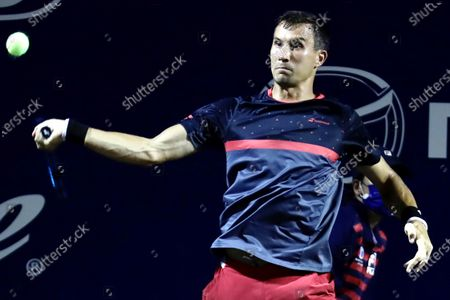 Yevgueni Donskoi of Russia in action against John Isner of the USA during the Los Cabos Open tennis tournament in Los Cabos, Baja California Sur, Mexico, 21 July 2021.