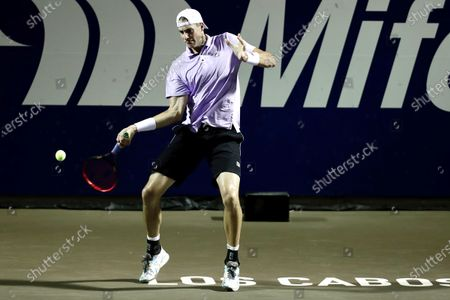 John Isner of the USA in action against Yevgueni Donskoi of Russia during the Los Cabos Open tennis tournament in Los Cabos, Baja California Sur, Mexico, 21 July 2021.
