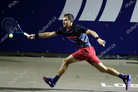 Stock Photo of Yevgueni Donskoi of Russia in action against John Isner of the USA during the Los Cabos Open tennis tournament in Los Cabos, Baja California Sur, Mexico, 21 July 2021.