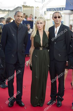 Jury's president Emmanuelle Beart arrives with jury members Faouzi Bensaidi and Abderrahmane Sissako
