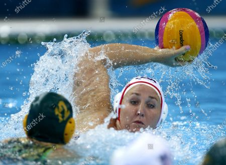 Melissa Seidemann, right, of the United States looks to pass against Nicola Zagame of Australia during a women's semifinal water polo match at the 2012 Summer Olympics in London. The U.S. women's water polo team got a big lift when Seidemann decided to go for a third straight gold medal at the Tokyo Olympics