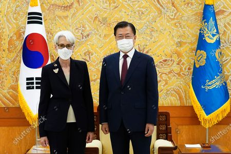 In this photo provided by South Korea Presidential Blue House, South Korean President Moon Jae-in and U.S. Deputy Secretary of State Wendy Sherman, left, pose for photos prior to their meeting at the presidential Blue House in Seoul, South Korea, . Top U.S. and South Korean officials agreed Thursday to try to convince North Korea to return to talks on its nuclear program, which Pyongyang has insisted it won't do in protest of what it calls U.S. hostility