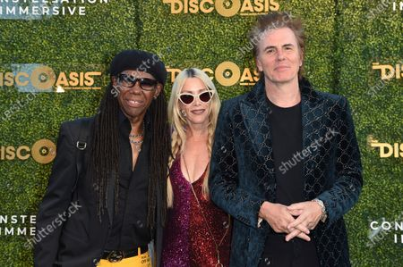Nile Rodgers, from left, Gela Nash and John Taylor arrive at the DiscOasis VIP event, at South Coast Botanic Garden in Los Angeles