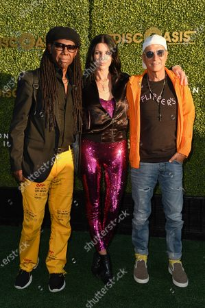 Nile Rodgers, from left, Liberty Ross and Jimmy Iovine arrive at the DiscOasis VIP event, at South Coast Botanic Garden in Los Angeles