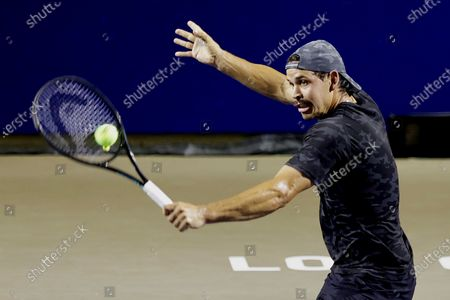 Stock Image of Alex Bolt of Australia in action against John Isner of the USA during their quarterfinals match at the Los Cabos Open tennis tournament in Los Cabos, Baja California Sur, Mexico, 22 July 2021.